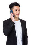 Young asian man talk to cellphone Stock Photos