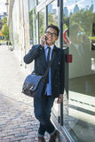 Young asian man talking on mobile phone Royalty Free Stock Photo