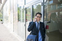 Young asian man talking on mobile phone Royalty Free Stock Images