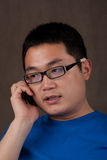 Young asian man talking on the phone Royalty Free Stock Photo