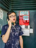 Young Asian man talking on street phone royalty free stock photos