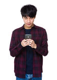 Young asian man texting message Stock Photos