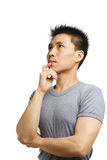 Young Asian man thinking Royalty Free Stock Photography