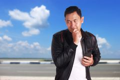 Young Asian Man Thinking Gesture Stock Images