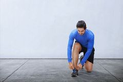 Free Young Asian Man Tie Sport Shoe Laces Before Running Stock Photos - 101086143