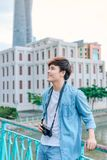 Young asian man tourist taking photos outdoor in the city.  Royalty Free Stock Photo