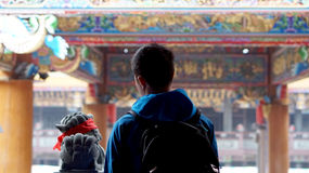 Young Asian man travel backpacker at chinese temple Stock Image