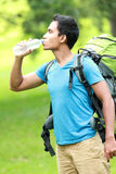 Young asian man travel backpacking drinking water Royalty Free Stock Images