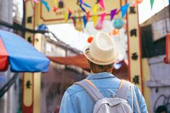 Young asian man traveler shopping walking on street market. Young asian man traveler shopping walking on street market royalty free stock photography