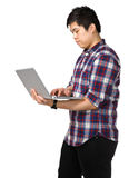 Young asian man using laptop computer Stock Image