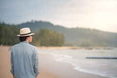 Young Asian man walking on the beach Royalty Free Stock Photography