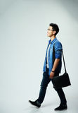 Young asian man walking Royalty Free Stock Photos