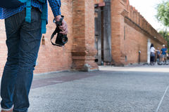 Young asian man wearing blue shirt and jeans with camera and bac Stock Image