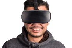 Young asian man wearing virtual reality goggles. Frontal headshot of smiling young asian man wearing virtual reality goggles, white background royalty free stock image