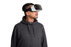 Young asian man wearing virtual reality goggles looking upwards. White background stock image
