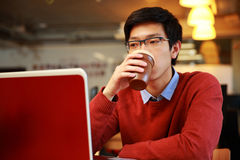 Young asian man working on laptop Stock Photography