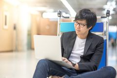 Young asian man working on trolley in airport terminal Royalty Free Stock Photography