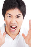 Young Asian Man Yelling Royalty Free Stock Photos