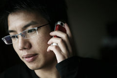 Young asian men on calling Stock Image