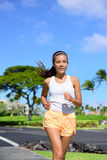 Young Asian mixed race woman jogging outside Royalty Free Stock Photography