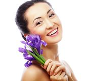 Young asian model with iris flowers. Royalty Free Stock Image