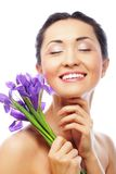 Young asian model with iris flowers. Stock Photography