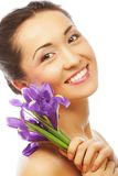 Young asian model with iris flowers. Royalty Free Stock Photography