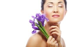 Young asian model with iris flowers. Royalty Free Stock Images