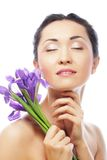 Young asian model with iris flowers. Royalty Free Stock Photo