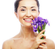 Young asian model with iris flowers. stock image