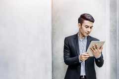 Young Asian and modern attractive Businessman Reading or Working Stock Image