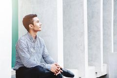 Young Asian and Modern Businessman sit and Looking forward for S Stock Images
