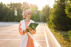 Young asian muslim business woman smiling and holding file document Royalty Free Stock Photo