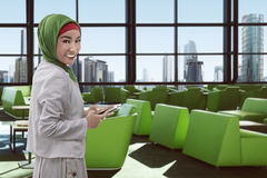 Young asian muslim woman on the airport Stock Image