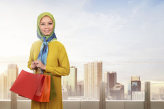 Young asian muslim woman enjoying shopping time Royalty Free Stock Photo