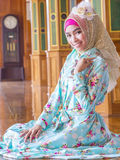 Young asian muslim woman in full decorated dress Stock Photography