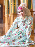 Young asian muslim woman in full decorated dress royalty free stock photo