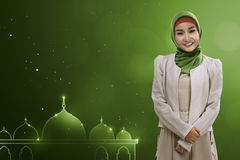 Young asian muslim woman give smile Stock Image