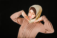 Young Asian Muslim woman in head scarf Stock Image