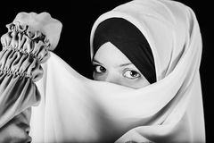 Young Asian Muslim woman in head scarf with the magic eyes Stock Images