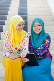 Young asian muslim woman in head scarf smile together Stock Photography