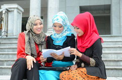 Young asian muslim woman in head scarf study together Stock Images