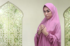 Young asian muslim woman with hijab praying to god Royalty Free Stock Images