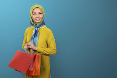 Young asian Muslim woman with shopping bag Royalty Free Stock Image