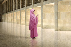 Young asian muslim woman with veil dress praying Royalty Free Stock Photo