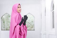 Young asian muslim woman in veil praying Royalty Free Stock Images