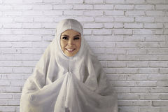 Young asian muslim woman wearing hijab give smile face Stock Photos