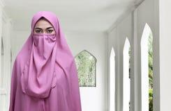 Young asian muslim woman wearing niqab traditional veil Stock Photo