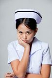 Young Asian nurse in bad mood Stock Photography