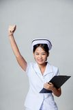 Young Asian nurse fist pump with success Stock Image